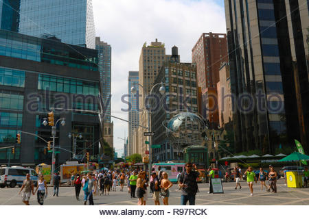NEW YORK, USA - August 30, 2018: The stainless steel Unisphere sculpture in front of Trump International Hotel and Tower at Columbus Circle - Stock Photo