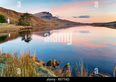 Beautiful sunrise over Loch Fada on the Isle of Skye with the Old Man of Storr in the distance - Stock Photo