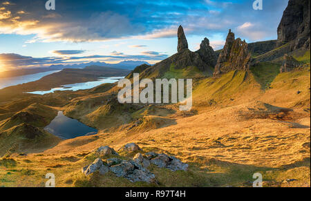 Stunning sunrise over the Old Man of Storr rock pinnacles on the isle of Skye in Scotland - Stock Photo