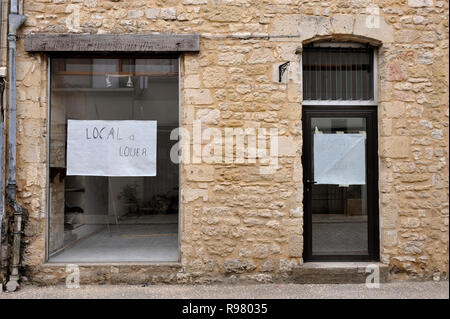 Shop to let in small village in France. (text on window in French 'Local a louer' means shop to let) - Stock Photo
