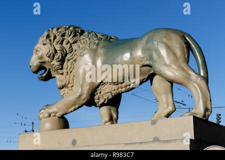 One of the two famous Lion sculptures on Palace Pier beside the Neva River in St Petersburg, Russia. - Stock Photo