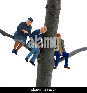 Miniature representing of the grand-parents and a young adult on tree branch, concept - Stock Photo