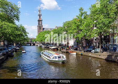 Tourist cruise boat on Prinsengracht canal in Amsterdam, Netherlands - Stock Photo