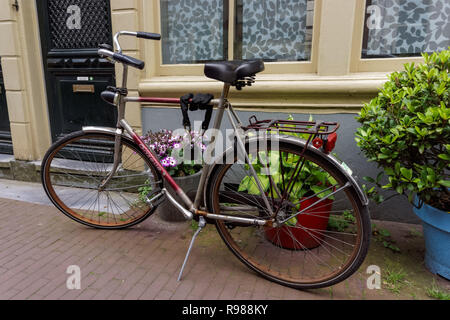 Dutch bicycles parked in front of residential building, Amsterdam, Netherlands - Stock Photo