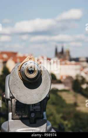 Coin operated binoculars on the viewing platform in Prague, in summer, the blurred city background. - Stock Photo