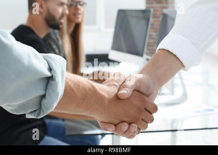 Business people shaking hands in the office after successful mee - Stock Photo