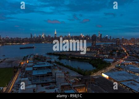 New York City and East River shows Chrysler Building on right and Empire State Building on Left, as seen from Queens - Stock Photo