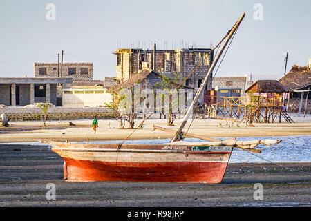 Boat at low tide in Lamu Kenya - Stock Photo