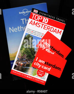 Lonely Planet, Eyewitness Travel Top 10 for Amsterdam, Holland, Netherlands together with I amsterdam cards - Stock Photo
