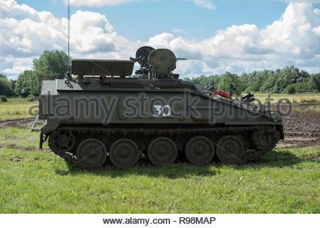 Wartime tank in a field - Stock Photo