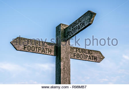 3 direction public footpath sign - Stock Photo