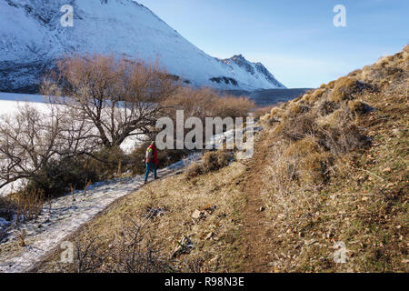 Woman Hiking Along Snowy Trail in Esquel, Chubut, Patagonia, Argentina - Stock Photo