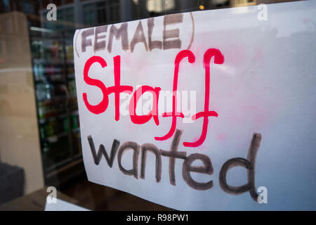 Female Staff Hand written wanted sign. in a cafe on Tottenham Court Rd, Bloomsbury, London W1, England - Stock Photo
