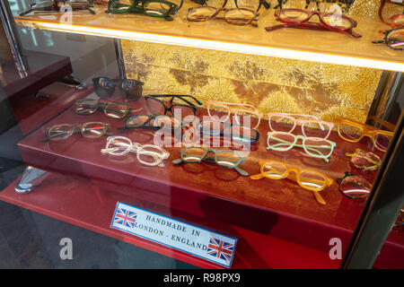 Closeup of shop window display of spectacle frames at an Opticians Shop in Tottenham Court Rd where they design and hand make spectacles in London, UK - Stock Photo