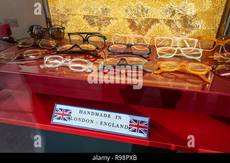 Closeup window display of spectacle frames at an Opticians Shop in Tottenham Court Rd where they design and hand make spectacles in London, England - Stock Photo