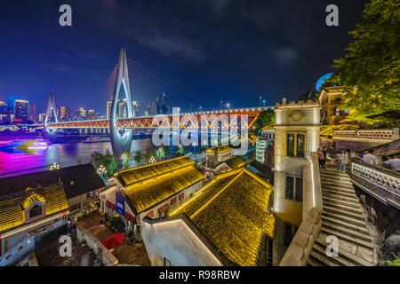 CHONGQING, CHINA - SEPTEMBER 22: Night view of traditional Chinese architecture Longmenhao old street and Dongshuimen bridge on September 22, 2018 in