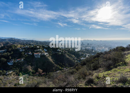 Clear morning view on canyon homes, Hollywood and downtown Los Angeles from hiking trail at Runyon Canyon Park. - Stock Photo