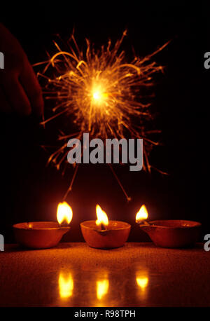 Diwali Festival fire cracker and oil lamps - Stock Photo