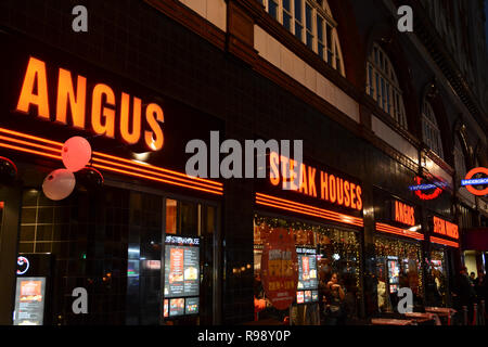 Angus Steak House restaurant and signage on Cranbourn Street  in London's West End, UK - Stock Photo