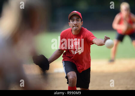 Softball players in Central Park in New York City - Stock Photo