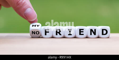 Hand is turning a dice and changes the expression 'no friend' to 'my friend' - Stock Photo