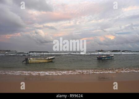 Unawatuna beach in Galle district at sunset, Sri Lanka - Stock Photo