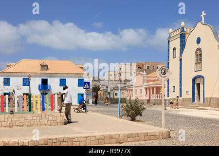 Scene in main square with cobbled street and catholic Church of St Isobel. Largo Santa Isobel, Sal Rei, Boa Vista, Cape Verde Islands, Africa - Stock Photo