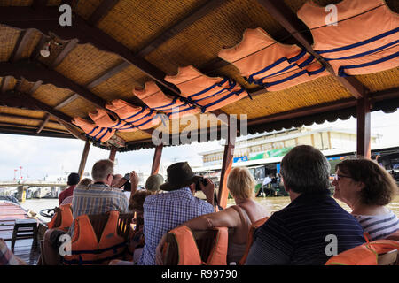 Lifejackets above tourists on a river boat trip day cruise sailing in Mekong Delta. Cai Be, Tiền Giang Province, Vietnam, Asia - Stock Photo