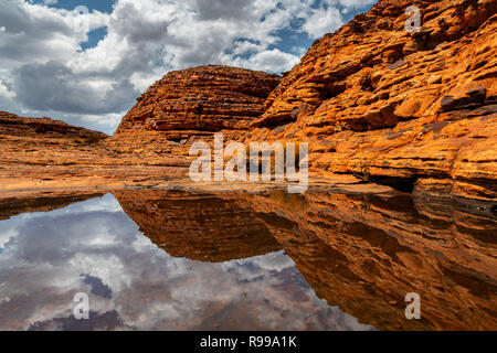 The domes of Watarrka (Kings Canyon) reflecting in water after rain. - Stock Photo