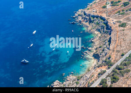 Rdum Il-Hmar cliffs and nice dive site between massive boulders near Mellieha in Northern Region of Malta. - Stock Photo