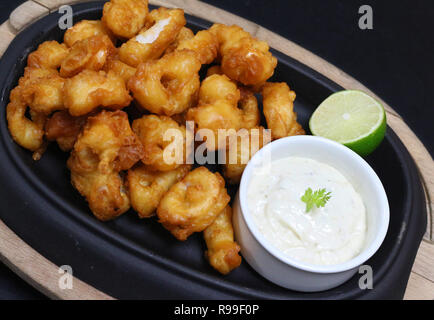deep fried tempura calamari with tartar sauce and lime - Stock Photo