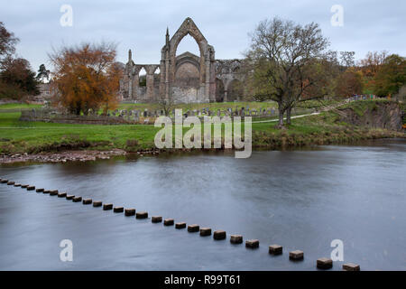 Bolton Abbey and Stepping Stones, Priory Ruins in Autumn, North Yorkshire Dales - Stock Photo