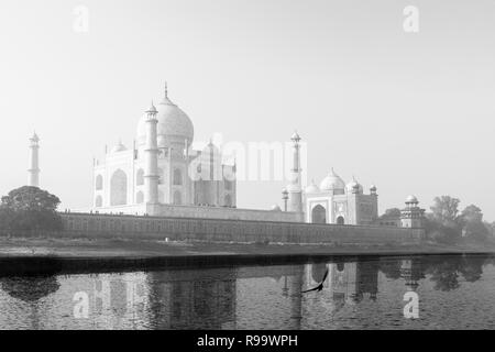 Taj Mahal reflected in Yamuna River in black and white. - Stock Photo
