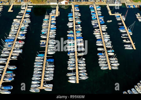 Bird's eye view on boats moored at berths in a yacht harbour at the Lake Geneva, Rolle, Vaud, Switzerland - Stock Photo
