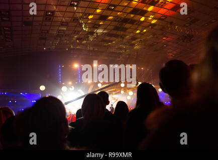 Silhouette of a concert crowd. The audience looks towards the stage. Party people at a rock concert. Musical party. Musical show. Group silhouette. Yo - Stock Photo