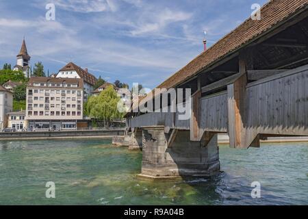 The Spreuer Bridge (Spreuerbrucke or Muhlenbrucke), one of two extant covered wooden footbridges in the city of Lucerne over Reuss River, Switzerland. - Stock Photo