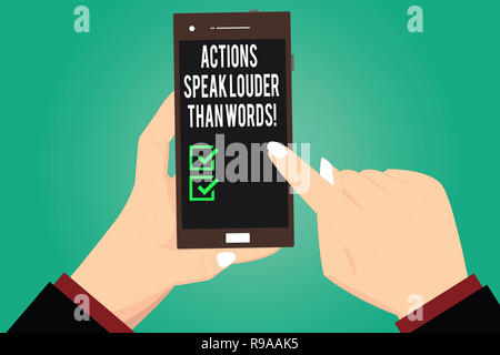 Handwriting text writing Actions Speak Louder Than Words. Concept meaning Make execute accomplish more talk less Hu analysis Hands Holding Pointing To - Stock Photo