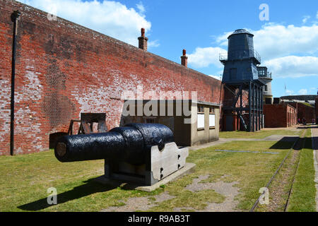 Cannon and lookout tower in the grounds of Hurst Castle, Milford on Sea, New Forest, Hampshire, UK - Stock Photo
