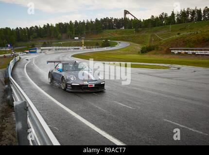 HÄMEENLINNA, FINLAND – APRIL 25 2016: A sportscar at high speed on racetrack at Ahvenisto Race Circuit in Finland. - Stock Photo