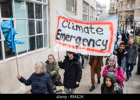 London, UK. 21st Dec, 2018. Environmental campaigners from Extinction Rebellion protest outside Broadcasting House against the lack of coverage by the BBC of the climate change crisis. Credit: Mark Kerrison/Alamy Live News - Stock Photo