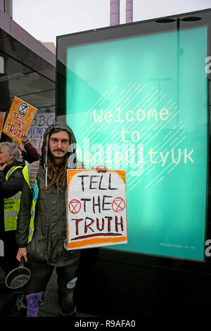 Salford, UK. 21st Dec, 2018. An Extinction Rebellion campaigner joins a protest outside the BBC to convey concern of the climate and ecological emergency. BBC, Media City, Salford, UK, 21st December 2018 (C)Barbara Cook/Alamy Live News Credit: Barbara Cook/Alamy Live News - Stock Photo