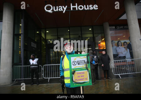 Salford, UK. 21st Dec, 2018. An Extinction Rebellion campaigner stood with a placard outside Quay House. BBC, Media City, Salford, UK. 21st Dec, 2018. (C)Barbara Cook/Alamy Live News Credit: Barbara Cook/Alamy Live News - Stock Photo