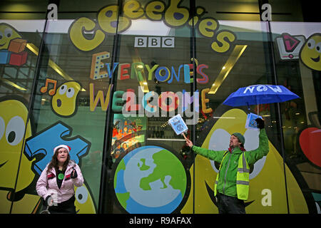 Salford, UK. 21st Dec, 2018. Extinction Rebellion campaigners stood at a window of the BBC Cbeebies, BBC, Media City, Salford, UK. 21st Dec, 2018. (C)Barbara Cook/Alamy Live News Credit: Barbara Cook/Alamy Live News - Stock Photo