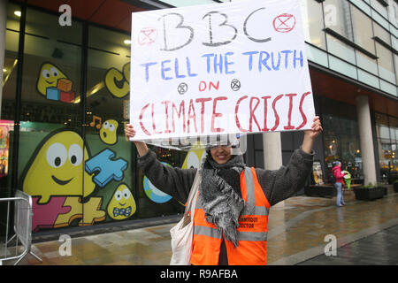Salford, UK. 21st Dec, 2018. An Extinction Rebellion campaigner holding a placard which reads 'BBC Tell The Truth on Climate Change'. BBC, Media City, Salford, UK, 21st December 2018 (C)Barbara Cook/Alamy Live News Credit: Barbara Cook/Alamy Live News - Stock Photo