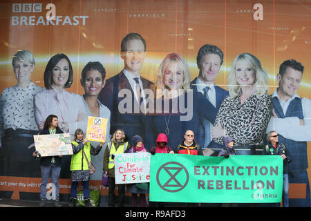 Salford, UK. 21st Dec, 2018. Extinction Rebellion campaigners stood under a BBC Breakfast team photo outside the BBC, Media City, Salford, UK. 21st Dec, 2018. (C)Barbara Cook/Alamy Live News Credit: Barbara Cook/Alamy Live News - Stock Photo