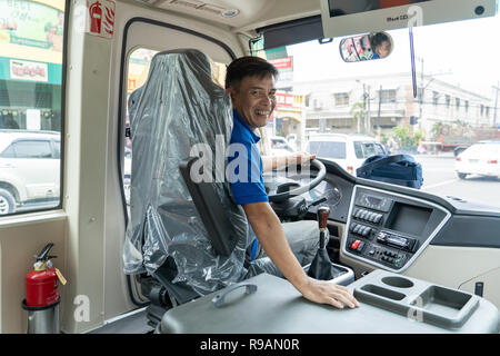 22/12/2018 Cebu City,Philippines.Driver of a new style modern Jeepneys deployed on the roads of Cebu City.Locally known as a 'Beep' they have a seating capacity of 24 passengers, and can accommodate an additional 10 standing. Each is equipped with free wifi, dashcam, and a closed circuit television (CCTV) camera.Starting in January 2018 the Department of Transportation (DOTr) in the Philippines started to remove jeepneys older than 15 years  as part of the government's transport modernization program. - Stock Photo