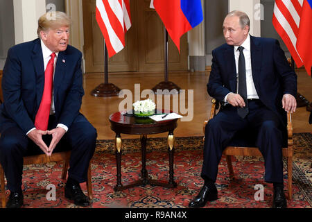 Beijing, Finland. 16th July, 2018. U.S. President Donald Trump (L) meets with his Russian counterpart Vladimir Putin in Helsinki, Finland, on July 16, 2018. Credit: Lehtikuva/Heikki Saukkomaa/Xinhua/Alamy Live News - Stock Photo