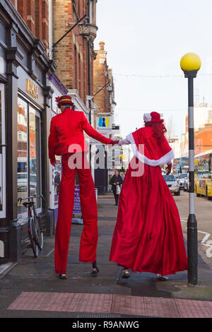 Westbourne, Bournemouth, Dorset, UK. 22nd Dec, 2018. Victorian style theatre with mesmerising walkabouts, irresistable characters and inspirational performers at Westbourne spread seasonal cheer on the last weekend before Christmas. Stiltwalkers looking for last minute Christmas presents? Credit: Carolyn Jenkins/Alamy Live News - Stock Photo