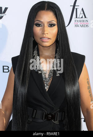 (FILE) Nicki Minaj Renamed Her Tour To 'The Nicki WRLD Tour' And Replaced Future With Juice WRLD. Nicki Minaj has finally revealed details surrounding her upcoming world tour 'The Nicki WRLD Tour'. Nicki has swapped out rap superstar Future with Chicago rap star Juice WRLD and she has cleverly renamed the outing from 'NickiHndrxx' to 'The Nicki WRLD Tour'. WEST HOLLYWOOD, LOS ANGELES, CA, USA - APRIL 02: Rapper Nicki Minaj arrives at the Daily Front Row's 3rd Annual Fashion Los Angeles Awards held at the Sunset Tower Hotel on April 2, 2017 in West Hollywood, Los Angeles, California, United Sta - Stock Photo