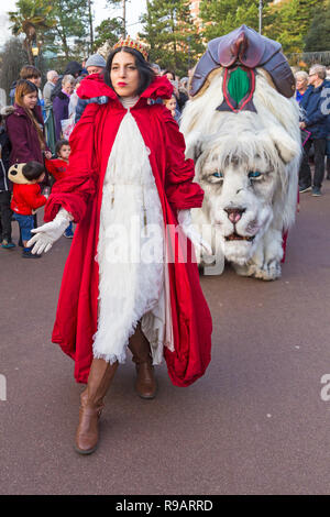 Bournemouth, Dorset, UK. 22nd December 2018. The Snow Lion and Red Queen do a walkabout through Bournemouth Lower Gardens for folk to see the mystey and majesty of the largest lion to walk the earth. From the Forest of Eternal Snow pads the giant white lion, a mythical emblem of the season celebrating the light of human kindness in  the depths of winters darkest days. Credit: Carolyn Jenkins/Alamy Live News - Stock Photo